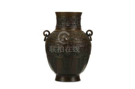 A CHINESE BRONZE VASE, HU. Qing Dynasty. Rising to rounded shoulders from a spreading neck with
