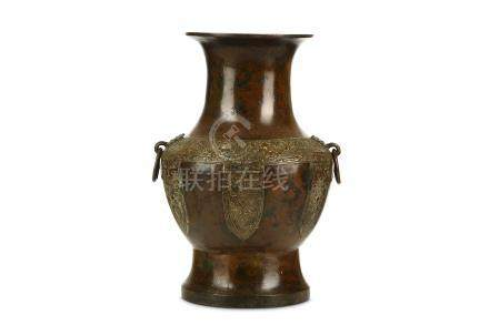 A CHINESE PARCEL GILT BRONZE VASE. Late Ming Dynasty. Of baluster form, the rounded body with wide