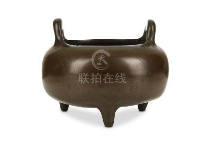 A CHINESE BRONZE TRIPOD INCENSE BURNER. Qing Dynasty. The globular body supported on short, bowed