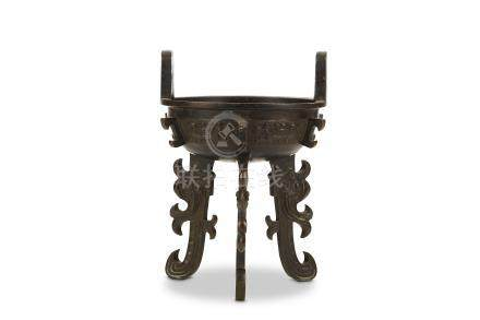 A CHINESE BRONZE INCENSE BURNER, DING. Ming Dynasty. Of archaistic form, the compressed