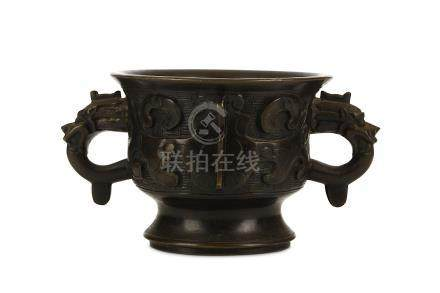 A CHINESE BRONZE INCENSE BURNER, GUI. Qing Dynasty. Of archaistic gui form, cast with a taotie mask