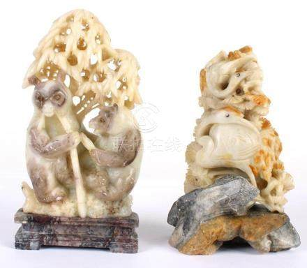TWO CHINESE SOAPSTONE CARVINGS - First, pair of red-capped c