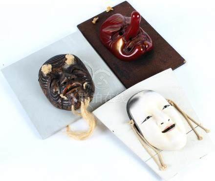 THREE DECORATIVE JAPANESE THEATRE MASKS - First, cast plaste