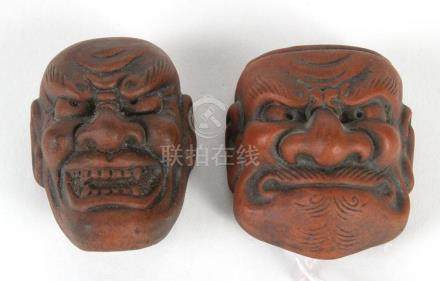 TWO JAPANESE NETSUKE POTTERY NOH MASKS - Both made of brown