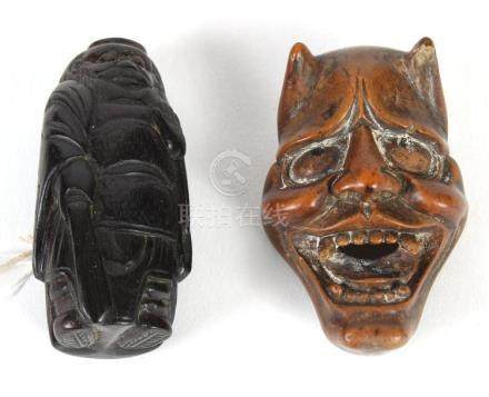 TWO CARVED WOOD JAPANESE NETSUKE; SHOKI WITH HIS SWORD AND A
