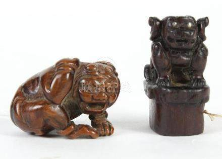 TWO JAPANESE CARVED WOOD NETSUKE - First is Shishi the Guard