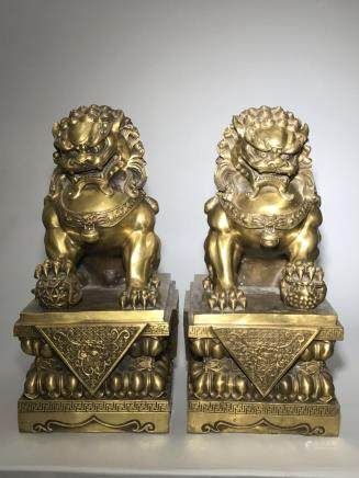 A Pair of Gilt Bronze Lions