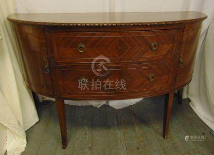 A mahogany Regency style D shaped sideboard with two drawers and two cupboards on tapering