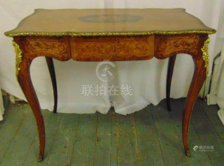 A French Louis XVI style rectangular desk with gilded metal mounts, kingswood inlays, single drawer,
