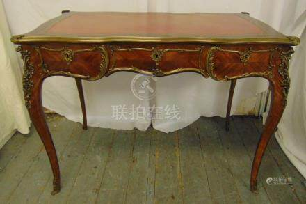 A French 19th century style Kingswood rectangular hall table with three drawers, gilded metal