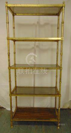 A gilded metal five tier rectangular display stand with glass and wooden shelves