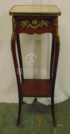 A rectangular marble top mahogany plant stand with applied gilded metal mounts on four cabriole