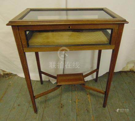 An Edwardian rectangular mahogany and glass display table on four tapering legs