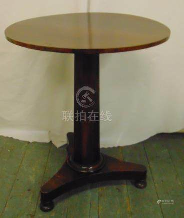 A mahogany circular occasional table on pedestal triform base