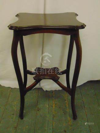 An Edwardian mahogany occasional table of shaped rectangular form on four cabriole legs