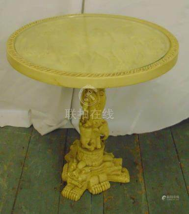 An Oriental composition circular table on carved triform base