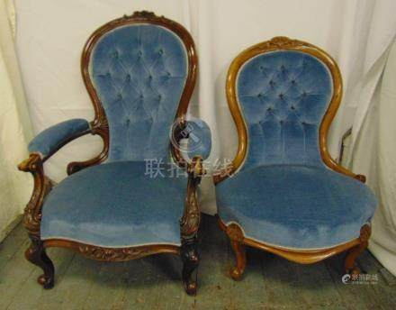 A Victorian upholstered mahogany armchair and a matching ladies chair