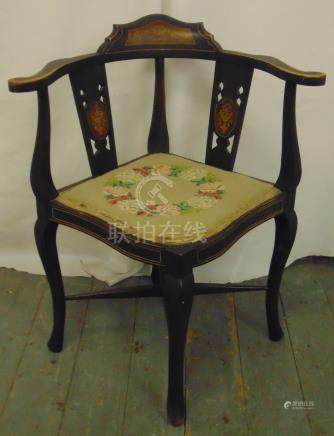 An Edwardian corner chair with pierced slat backs upholstered seat on four scroll legs