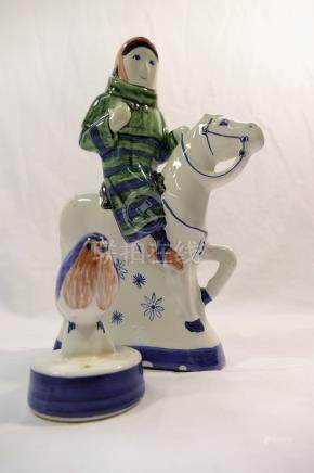 A Rye Pottery figure of a woman on a horse, 21.