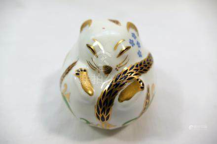A Royal Crown Derby bone china paperweight of a doormouse, with gold stopper,