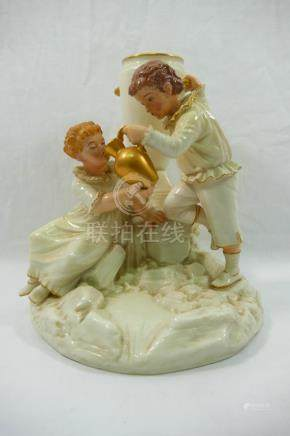 A Royal Worcester porcelain figural spill holder by James Hadley modelled as a boy and a girl