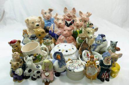 A collection of modern Wade figures including 'Mother Goose', 'Cinderella',