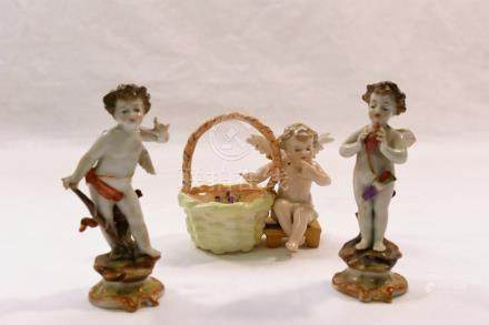 Two small 19th century porcelain figures of Cupid, one modelled holding a flaming heart,