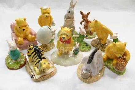 A collection of 12 Royal Doulton Winnie the Pooh figures, comprised of 'Piglet and Honey Pot',