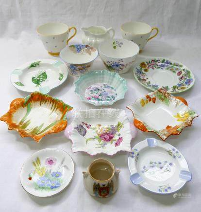 Fourteen pieces of Shelley bone china comprised of three small square two-handled dishes,