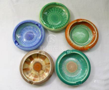 Five Shelley Harmony ashtrays, three 11cm diameter and two 10.