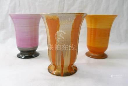 Three Shelley Harmony vases, each raised on a circular foot, 11.