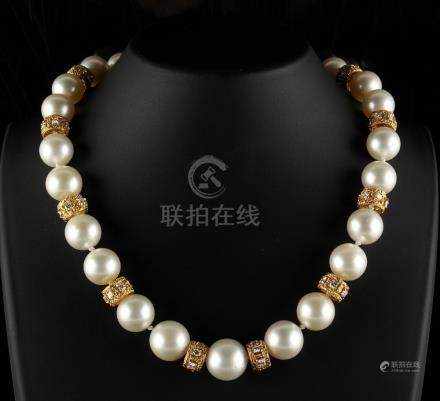 A fine yellow gold pearl & diamond necklace by Wempe, the twenty-four large pearls ranging from 11.