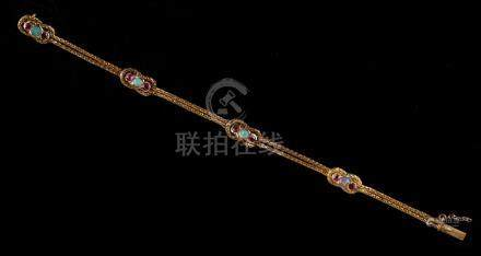 An 18ct yellow gold ruby & opal chain bracelet, with four opals & eight rubies set in interlaced