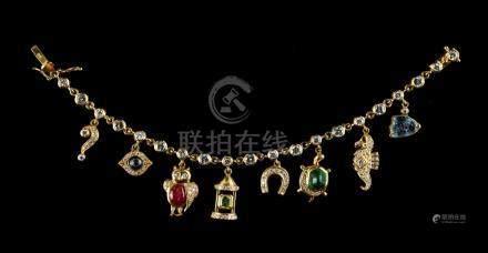 A fine charm bracelet by Adler, the 18ct yellow gold diamond set bracelet with eight multi gem set