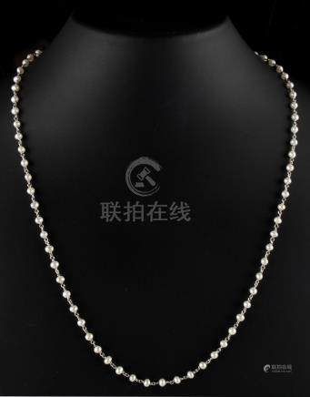 An 18ct white gold & pearl chain link necklace, the seventy-six untested pearls each approximately