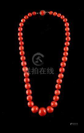 A good coral graduated bead necklace, the forty-four faceted beads ranging from approximately 7.3 to
