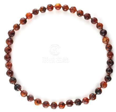 A good certificated amber bead necklace, the forty large individually strung Burmese amber beads