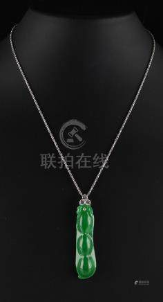 A very fine certificated untreated Chinese carved apple green jadeite pendant modelled as a bean