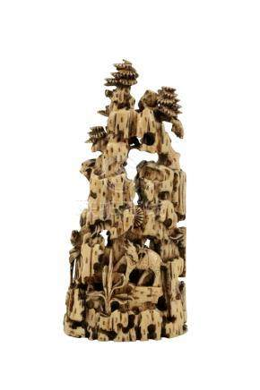 CARVED IVORY GROUP, QING DYNASTY, EARLY 19TH CENTURY