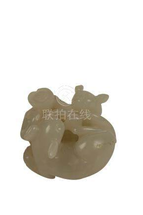 SMALL WHITE JADE CARVING OF TWO CATS, QING DYNASTY, 19TH CENTURY
