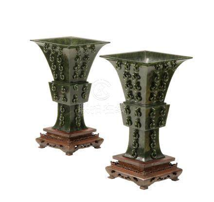 PAIR OF GREEN-SPINACH JADE GU-FORM VASES, QING DYNASTY, 19TH CENTURY