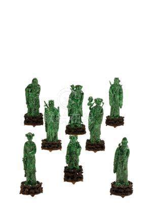 RARE SET OF EIGHT CARVED CHLOROMELANITE IMMORTALS, QING DYNASTY, 19TH CENTURY