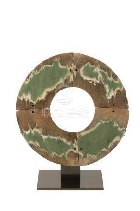 EXCEPTIONALLY LARGE JADE DISC, SHANG OR WESTERN ZHOU STYLE OF NORTH WEST CHINA