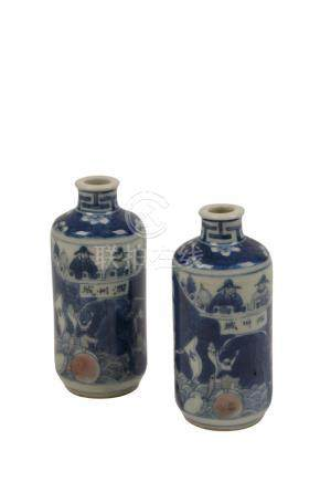PAIR OF SMALL BLUE AND WHITE COPPER-RED VASES, QING DYNASTY, 19TH CENTURY