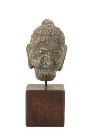 SANDSTONE HEAD OF A BUDDHA, INDIAN 11TH / 12TH CENTURY OR LATER
