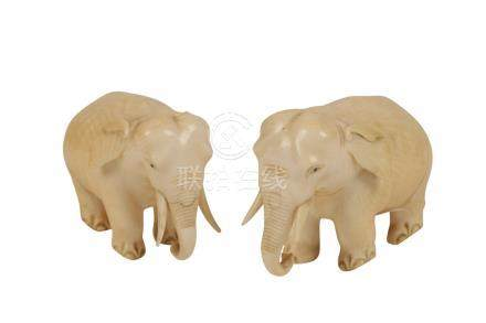 PAIR OF CARVED IVORY ELEPHANTS, INDIAN