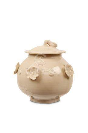 A CHINESE DINGYAO 'LOTUS' JAR AND COVER. Song Dynasty. The globular body supported on a tapering
