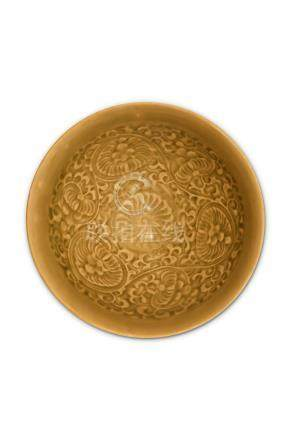A CHINESE YAOZHOU TEA BOWL. Song Dynasty. The interior moulded with six peony blossoms borne on an