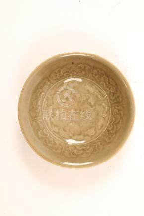 A CHINESE YAOZHOU CELADON BOWL. Song Dynasty. Of conical form, with shallow rounded sides and an