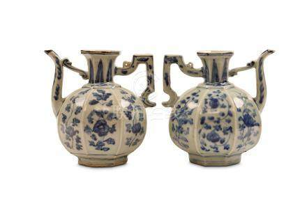A NEAR PAIR OF CHINESE OCTAGONAL BLUE AND WHITE EWERS. Ming Dynasty, 16th Century. Of octagonal